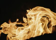 Blaze fire flame background and textured, orange and black. Fire bonfire oven blaze stove coal burn texture fireplace grill wood climate blazing energy hot hell royalty free stock images