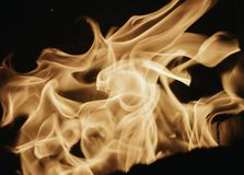 Blaze fire flame background and textured, orange and black. Fire bonfire oven blaze stove coal burn texture fireplace grill wood climate blazing energy hot hell stock photo