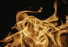 Blaze fire flame background and textured, orange and black. Oven flaming stove coal burn fireplace grill wood climate blazing energy hot hell inferno structure stock image