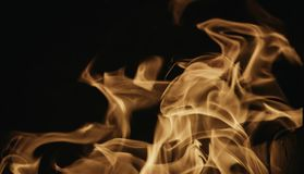 Blaze fire flame background and textured, orange and black. Oven stove coal burn fireplace grill wood climate blazing energy hot hell inferno structure fiery stock photo