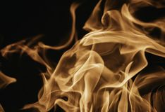Blaze fire flame background and textured, orange and black. Oven flaming stove coal burn fireplace grill wood climate blazing energy hot hell inferno structure royalty free stock photography