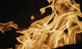 Blaze fire flame background and textured, orange and black. Oven stove coal burn fireplace grill wood climate blazing energy hot hell inferno structure fiery stock photography