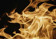 Blaze fire flame background and textured, orange and black. Oven flaming stove coal burn fireplace grill wood climate blazing energy hot hell inferno structure stock photos