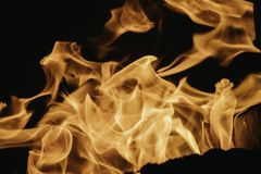 Blaze fire flame background and textured, orange and black. Oven flaming stove coal burn fireplace grill wood climate blazing energy hot hell inferno structure royalty free stock image