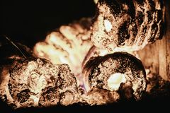 Blaze fire flame in oven, orange and black. Bonfire stove coal burn texture fireplace grill wood climate blazing energy hot hell inferno background fiery ember stock photo
