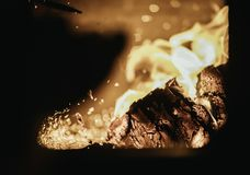 Blaze fire flame in oven, orange and black. Bonfire stove coal burn texture fireplace grill wood climate blazing energy hot hell inferno background fiery ember stock photography
