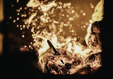 Blaze fire flame in oven, poking stick and sparks. Stove coal burn texture fireplace grill wood poker climate blazing energy hot hell inferno background fiery stock image