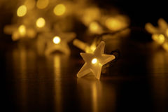 Blaze of lights with festively illuminated light chain Stock Images