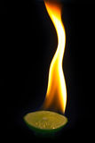 Blaze on a part of lime with black background Royalty Free Stock Photo