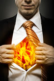 Blaze in soul. Businessman  in black costume throw open one's shirt, blaze in soul Stock Photo