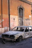 Blazed car in Rome Stock Photo