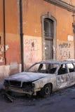Blazed car in Rome Stock Photo