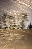 Blazende sneeuw bij nacht Stock Fotografie