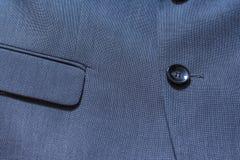 Blazer-Nahaufnahme-Beschaffenheits-Detail-Textilblaue Smokings-Klage Professio stockbilder