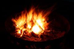 Blazing Campfire. View of a blazing campfire in the dark night Stock Photo