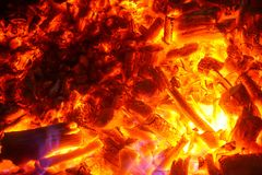 Blazing charcoal glows in the dark. Burning charcoal glows in the dark. Macro shot in detail Royalty Free Stock Photo
