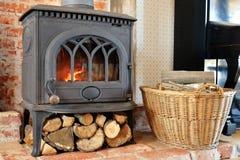Blazing fire in classic fireplace inside loft interior stock photo