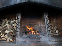 Blazing fire with stack of logs Stock Photo
