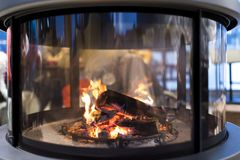 Blazing firewoods in a modern fireplace. Close-up od blazing firewoods in a modern fireplace Royalty Free Stock Photography