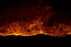 Blazing flames on black background Stock Photo