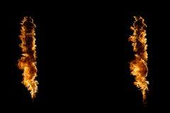 Blazing flames on black Stock Photos