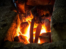 Blazing furnace at the blacksmith's Stock Images