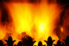 Blazing heat. A peat fire blazing with orange and yellow flames stock photos