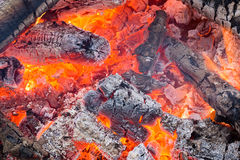 Blazing red coals in the fire Stock Photography