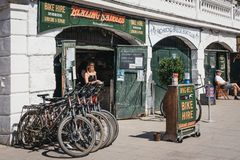 Blazing Saddles bike hire on the River Thames riverside in Richmond, London, UK. Blazing Saddles bike hire on the River Thames riverside in Richmond, a suburban stock photography