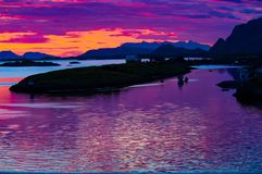 Incredible colors on midsummer sky at Norwegian Sea, North Norway stock photos