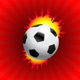 Blazing Soccer Ball on Red Background Stock Images