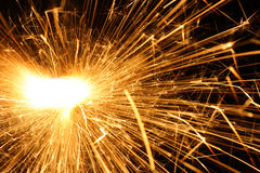 Blazing sparks. Close-up over black background stock photography