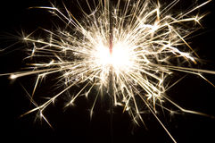 Blazing sparks. Close-up on the black background Royalty Free Stock Images