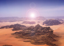 Blazing sun across desert. A picture of the desert in Rum, Jordan, with the sun blazing across the land, creating some lens flare effects stock photos