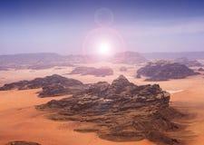 Blazing sun across desert stock photos