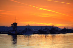 Blazing sunset sky over port Royalty Free Stock Image