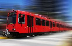 Blazing trolley. Beautiful red trolley moving fast through downtown Royalty Free Stock Image