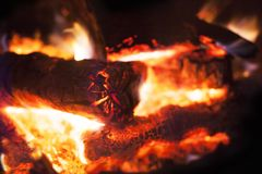 A blazing wood fire in fireplace. Vignetted in black to spotlight fire Stock Photo
