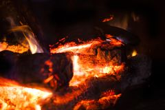 A blazing wood fire in fireplace. Vignetted in black to spotlight fire Royalty Free Stock Photography
