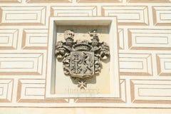 Blazon on renaissance wall. Stone noble blazon on renaissance wall with envelopes on plaster of castle Breznice in Czech Republic Royalty Free Stock Photos