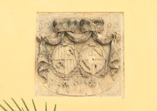 Blazon. Stone noble blazons with crones on yellow wall Royalty Free Stock Photos