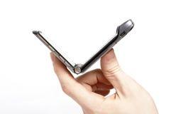bläddra den mobila telefonen Arkivfoto