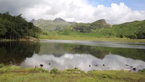 Blea Tarn between Great Langdale and Little Langdale Lake District Cumbria England UK PAN Stock Photo