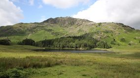 Blea Tarn between Great Langdale and Little Langdale Lake District Cumbria England UK Royalty Free Stock Images