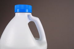 Bleach Bottle. Half Gallon bleach bottle on gray background royalty free stock photo