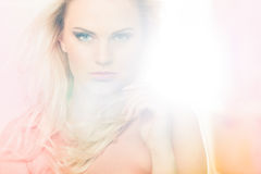 Bleached light. Portrait of a beautiful female model in bleached light stock photography