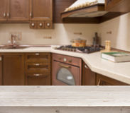 Bleached table on defocused brown kitchen interior background Royalty Free Stock Photo