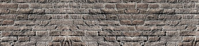 Bleached vintage brick wall texture in contrast lighting for design. Panoramic background for text and image.  royalty free stock photography