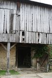 Bleached wood Barn. This bleached wood barn on stone foundation is a photographers dream even as close to the road as it is royalty free stock photo