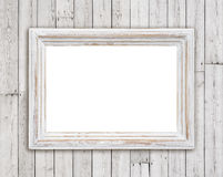 Bleached wooden picture frame on vintage plank wall background.  Stock Photos
